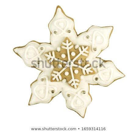 gingerbread cookies hanging over old wooden background flat lay stock photo © yatsenko