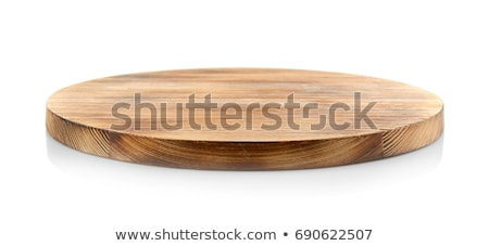 Empty white plate on a round wooden board stock photo © d_duda