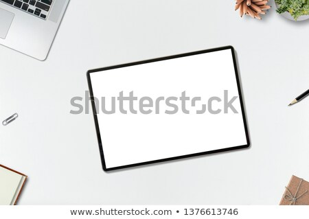 Overhead of laptop, digital tablet and diary on wooden table Stock photo © wavebreak_media