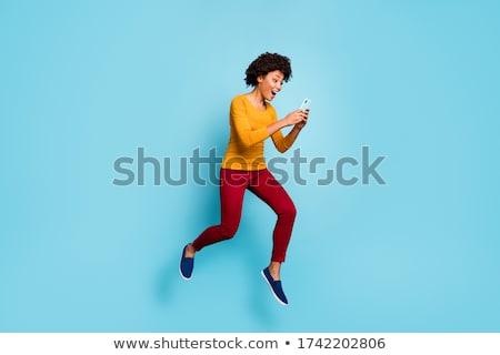 gülen · genç · kadın · atlama · hava · mutluluk · özgürlük - stok fotoğraf © dolgachov