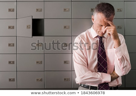 Businessman with head in locker Stock photo © IS2