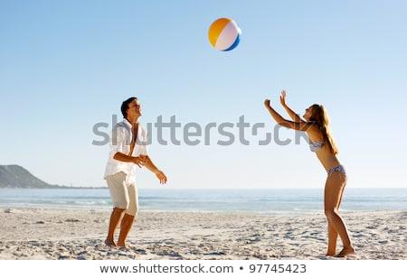 casal · praia · jogar · bola · prestados · alto - foto stock © is2