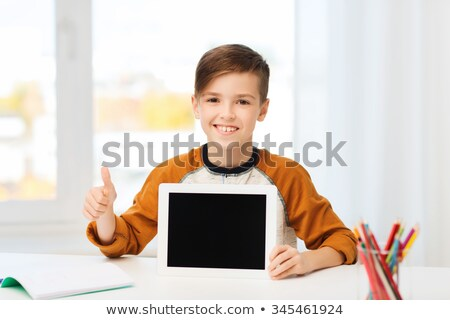 Stock photo: student with tablet pc showing thumbs up at home