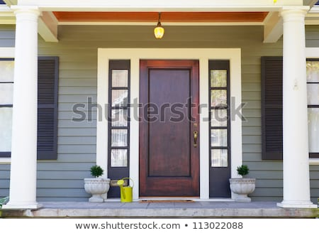 Wooden entrance porch with glass stained front door. Stock photo © iriana88w