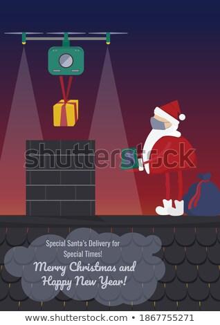Santa delivery gift through chimney Stock photo © colematt