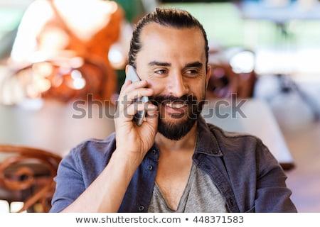 счастливым человека призыв смартфон Бар Паб Сток-фото © dolgachov