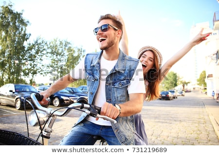 happy couple with bicycles at summer park stock photo © dolgachov