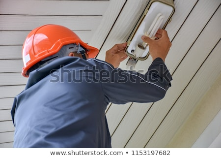 Repairman Checking Outdoor Electric Lamp Light Stock photo © AndreyPopov