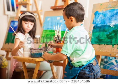 school lesson of arts and drawing pupils at class stock photo © robuart