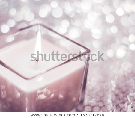 Blush pink aromatic candle on Christmas and New Years glitter ba Stock photo © Anneleven