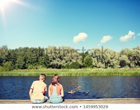 пару реке глядя плаванию Летние каникулы любви Сток-фото © dolgachov