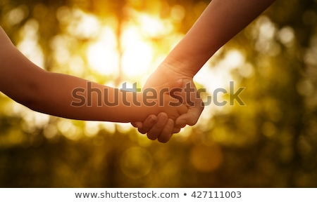 Foto stock: Mother Holding Hand Of Children