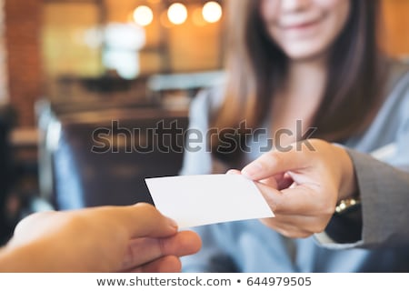 Vrouw tonen visitekaartje jonge vrouwelijke professionele Stockfoto © ashumskiy