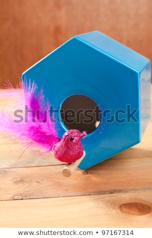 bird in blue nest house polygonal shape Stock photo © lunamarina