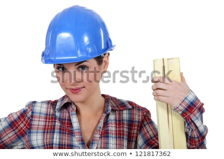 Tradeswoman holding a plank of wood Stock photo © photography33