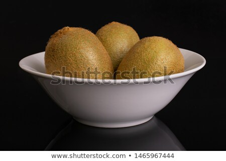 Kiwifruit in a bowl Stock photo © ColinCharisma