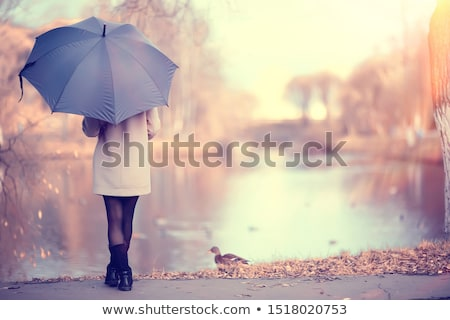 Pretty long hair woman with umbrella Stock photo © imarin