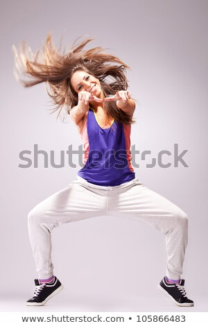 nő · táncos · mutat · gyönyörű · fiatal · nő · kamera - stock fotó © feedough