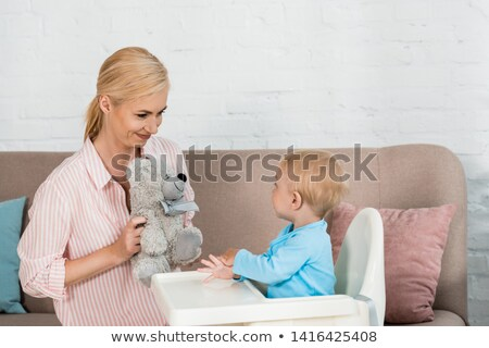 attractive blonde holding teddy bear stock photo © acidgrey