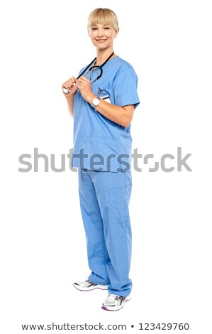 casual portrait of a confident physician standing sideways stock photo © stockyimages