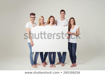 Male student holding a white board against white background Stock photo © wavebreak_media
