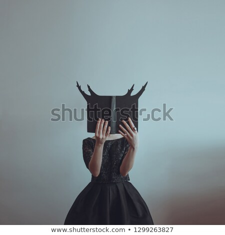 Stock photo: Attractive young witch in Victorian outfit
