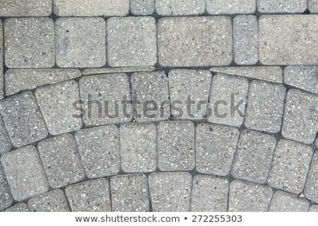 Circular inlaid pattern in grey brickwork Stock photo © ozgur