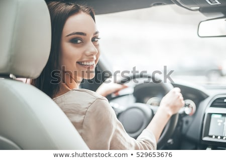 Young woman driving her car Stock photo © vlad_star