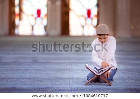 Muslim kid reading Quran Stock photo © zurijeta