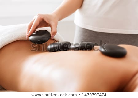 Hot stone massage happiness Stock photo © sumners
