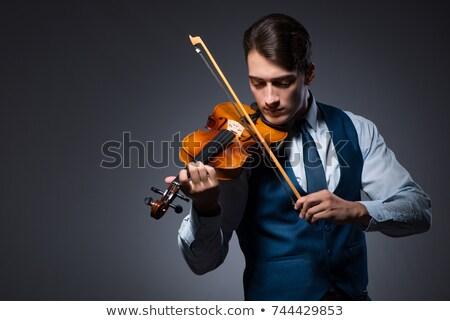 Fiatalember játszik hegedű közelkép portré férfi Stock fotó © MilanMarkovic78