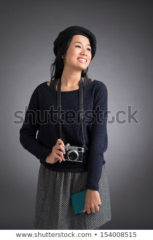 Young woman in casual clothes standing and holding retro camera Stock photo © deandrobot