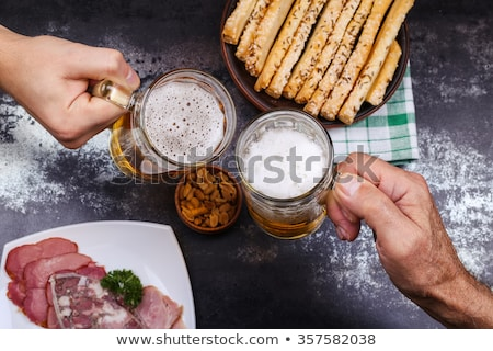 serving beer and snacks stock photo © fisher