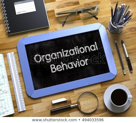 Small Chalkboard with Organizational Behavior Concept. 3D. Stock photo © tashatuvango