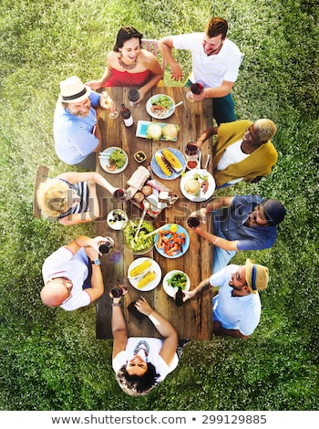 Group enjoying meal in garden Stock photo © IS2