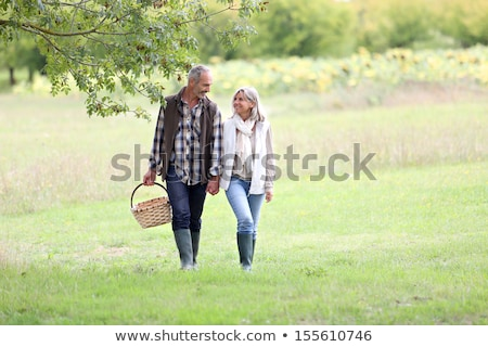 Married couple walking in a field Stock photo © IS2