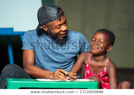 Father assisting daughter in her studies Stock photo © wavebreak_media