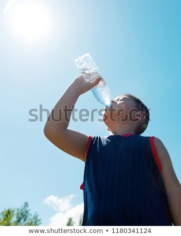 Low angle of boy drinking water Stock photo © IS2