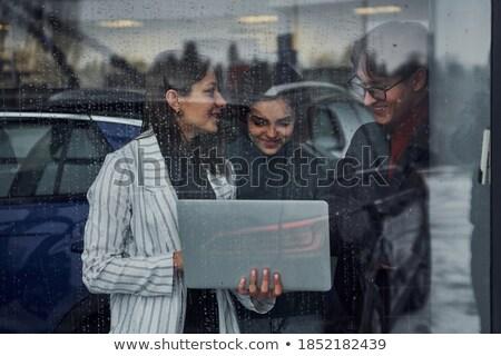 Três pessoas felizes suporte atrás vidro escritório Foto stock © IS2