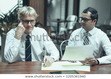 Portrait of senior business man at the front desk of a hotel Stock photo © IS2