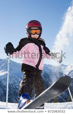 Young girl flicking snow off her skis Stock photo © IS2
