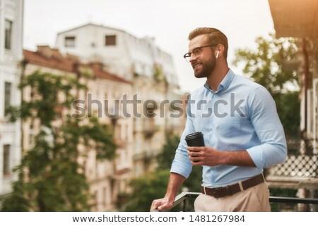 Genç ayakta balkon portre Stok fotoğraf © IS2