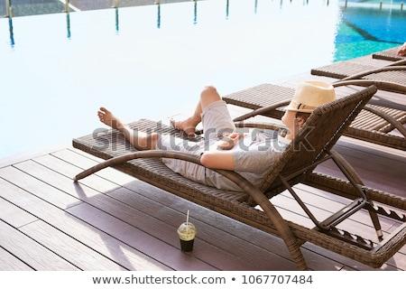 senior woman lying on sun lounger stock photo © is2