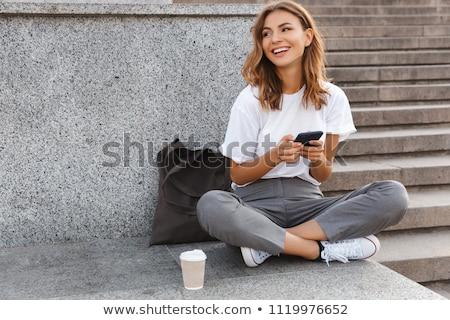 kadın · genç · kız · oturma · veranda · gülümseyen · kadın · gülen - stok fotoğraf © is2