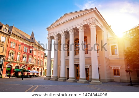 Subotica central square and peoples theater building evening vie Stock photo © xbrchx