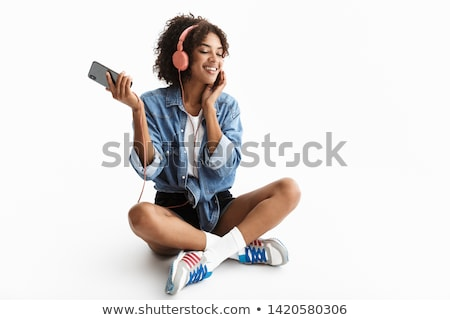 Optimistic african american woman in casual clothing holding pap Stock photo © deandrobot