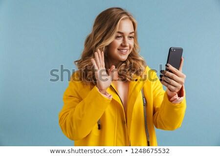 画像 女性 20歳代 着用 黄色 ストックフォト © deandrobot