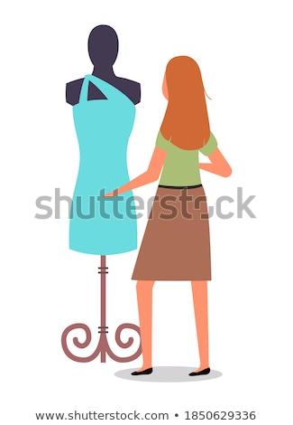 Kadın bakıyor manken elbise depolamak vektör Stok fotoğraf © robuart