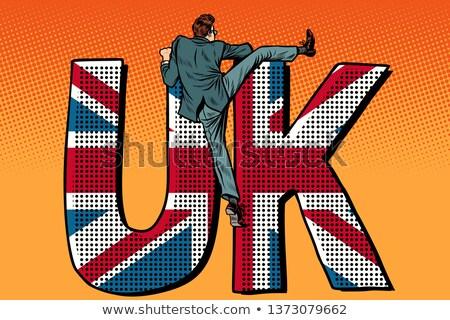 businessman overcomes the border uk word flag stock photo © studiostoks