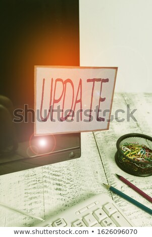 New modern laptop with black screen, up-to-date equipment and green flowerpot on an office table. Gr Stock photo © artjazz